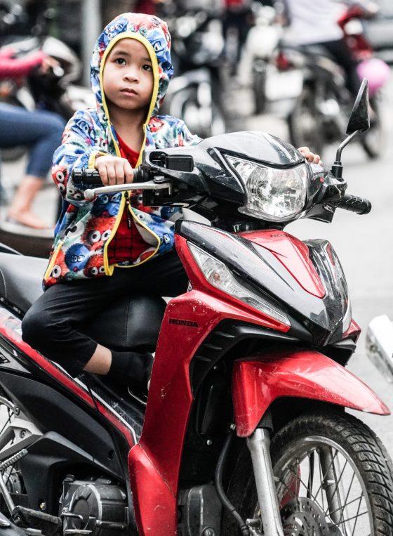 VIETNAMESE BOY ON MOTORBIKE