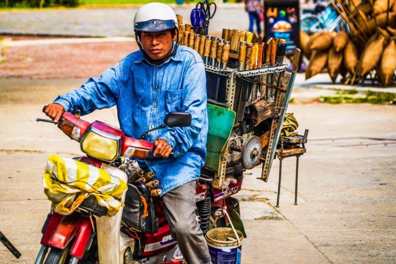 Knife sharpener on motorbike in Vietnam
