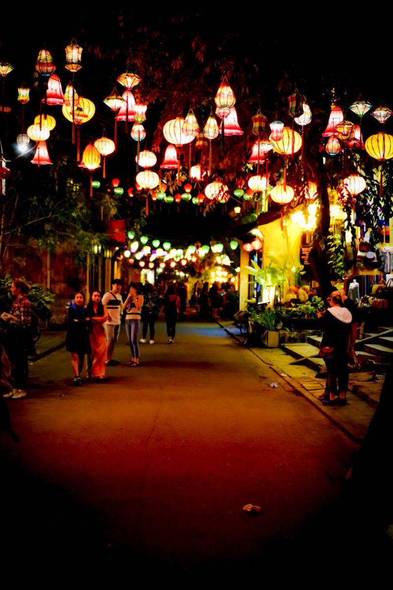 Night time street scene in Huey with lanterns